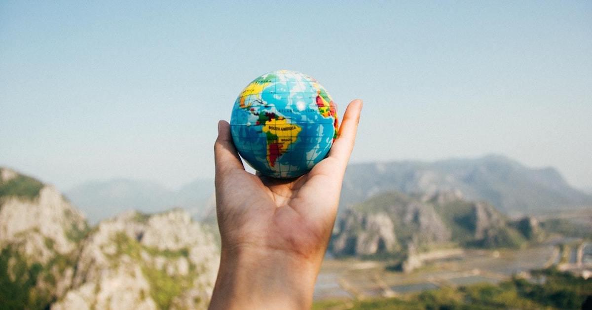 World globe facing mountains